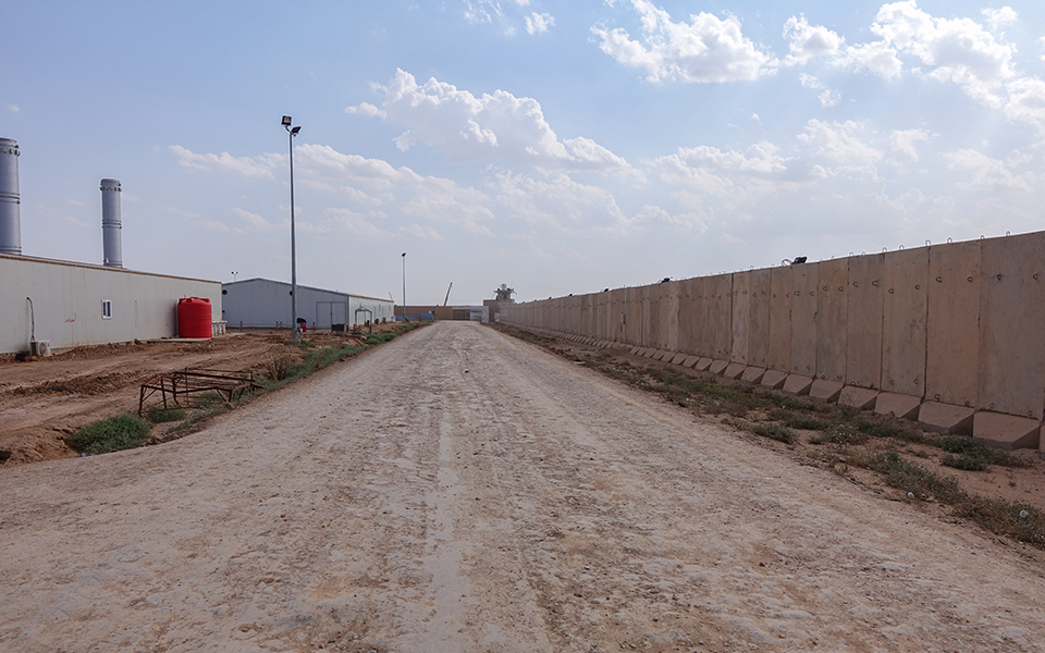 The surrounding wall securing the construction site in Iraq